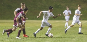 Richmond Observer File Photo: Raiders forward Carlos Alcocer (9) in action earlier this season against Lumberton. Richmond fell 5-0 to the Pirates Wednesday night.