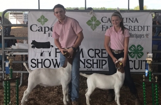 Coleman Lee Berry (left) and Ava Berry (right) show off their goats. Both competed and did well at the 2017 N.C. State Fair.