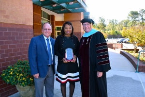 Dr. Hal Shuler, associate vice president for Development, left, and Dr. Dale McInnis, president of Richmond Community College, stand with the Outstanding Alumni Award winner, Dr. Yolanda VanRiel.