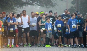 Runners line up at the starting line at a previous Seaboard 5K race.