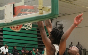 Senior forward Xavier Pettigrew slams a two-handed jam in the second quarter of Richmond's 59-50 win over Scotland.