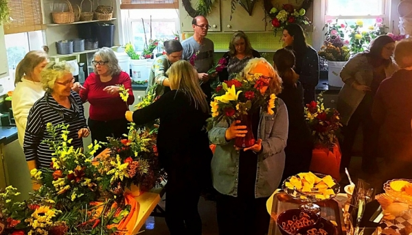 Hillside Florist owner Chuck Wright leads a group of attendees through the process of building their own custom flower arrangements.
