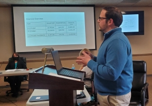 Hamlet City Manager Matthew Christian reviews department requests during a budget workshop Wednesday afternoon.