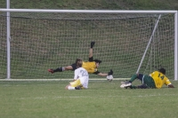 Senior Richmond goalkeeper Marcos Acosta makes an attempt to stop Pine Forest's Isaiah Bennett's shot.