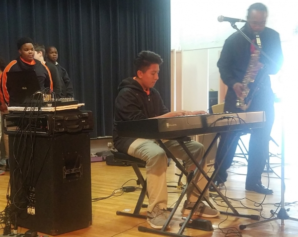 "Eighth-grader Fred Garcia shows off his keyboard skills Monday during Rockingham Middle School's Fine Arts Festival with a rendition of Stevie Wonder's ""Superstition."""