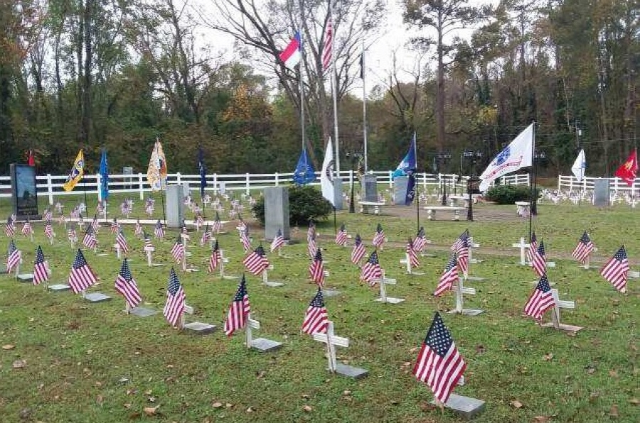Small U.S. flags adorn the grounds of Veterans Memorial Park, where a Veterans Day service will kick off a day of events on Saturday.