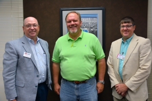 Richmond Community College will be providing customized training for ITG to help improve efficiency in its production lines. Pictured are Dr. Dale McInnis, RichmondCC president; Ed Cox, ITG plant manager; and Lee Eller, director of Customized Training.