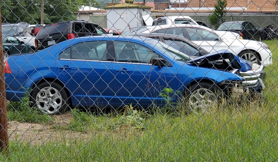Investigators with the Hamlet Police Department say the owner of the blue Ford car, Steven Bullard, ran into a light pole near Steve's Pizza early Saturday morning and his body was found in City Lake early Sunday afternoon.