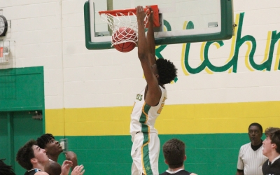 Junior Jarvis Tillman slams home a dunk in the third quarter of Richmond's loss to Reagan Monday.